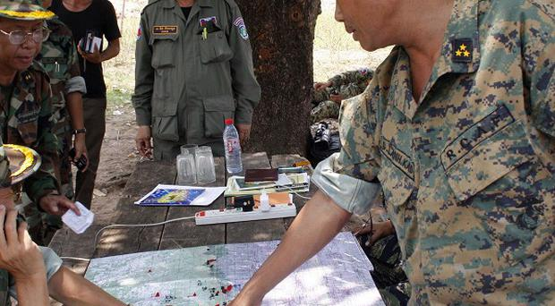 A commander of Cambodian Royal Armed Forces gives instructions at a camp in the disputed area in Oddar Meanchey province (AP)