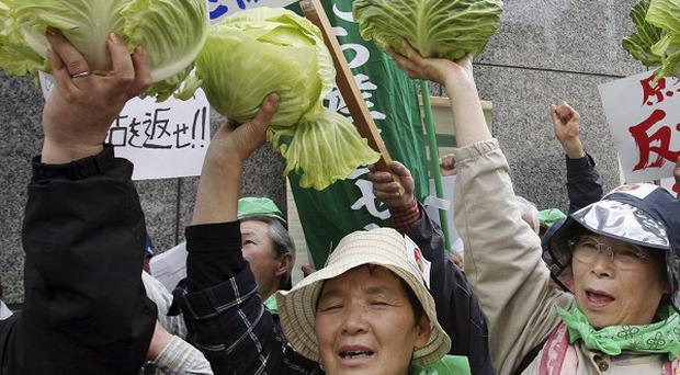 Farmers protest in front of the Tokyo Electric Power Co headquarters in the Japanese capital (AP)