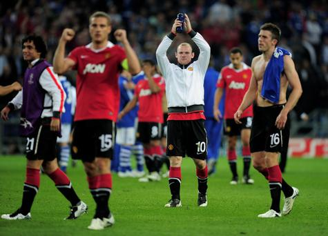 GELSENKIRCHEN, GERMANY - APRIL 26: Wayne Rooney of Manchester United and his team mates celebrate at the end of the UEFA Champions League Semi Final first leg match between FC Schalke 04 and Manchester United at Veltins Arena on April 26, 2011 in Gelsenkirchen, Germany. (Photo by Jamie McDonald/Getty Images)