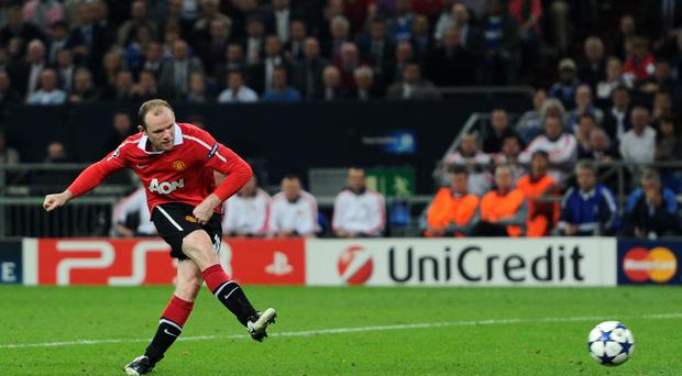 GELSENKIRCHEN, GERMANY - APRIL 26: Wayne Rooney of Manchester United scores his team's second goal during the UEFA Champions League Semi Final first leg match between FC Schalke 04 and Manchester United at Veltins Arena on April 26, 2011 in Gelsenkirchen, Germany. (Photo by Lars Baron/Bongarts/Getty Images)