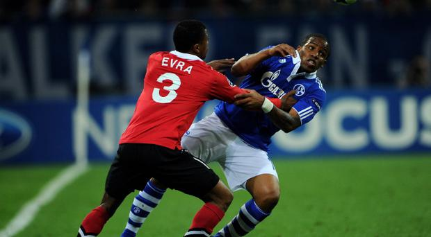 GELSENKIRCHEN, GERMANY - APRIL 26: Jefferson Farfan of Schalke competes with Patrice Evra of Manchester United during the UEFA Champions League Semi Final first leg match between FC Schalke 04 and Manchester United at Veltins Arena on April 26, 2011 in Gelsenkirchen, Germany. (Photo by Lars Baron/Bongarts/Getty Images)