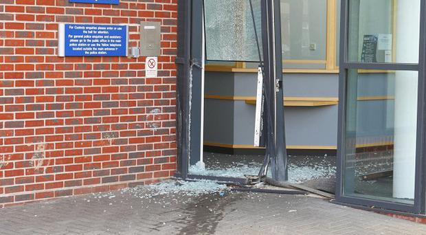 A man has been arrested after a car was repeatedly driven into a police custody suite