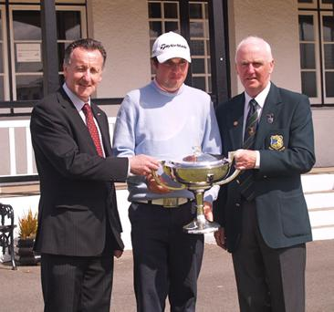 Portstewart's Paul Cutler receives his West of Ireland trophy yesterday