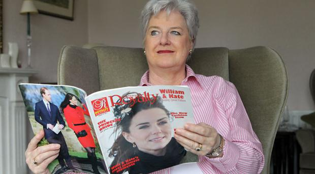 Kay Clarke with some of her memorabilia as she prepares to watch the wedding in her east Belfast home