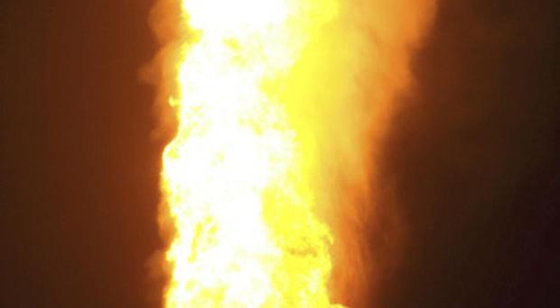 Flames rise over the al-Sabil natural gas terminal after an explosion near the town of El-Arish, Egypt, 30 miles (50 kilometers) from the border with Israel, early Wednesday, April 27, 2011.