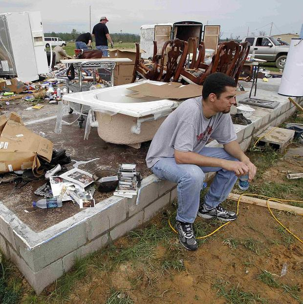Ken Sanders sits outside his in-laws' destroyed home in Vilonia, Arkansas (AP)