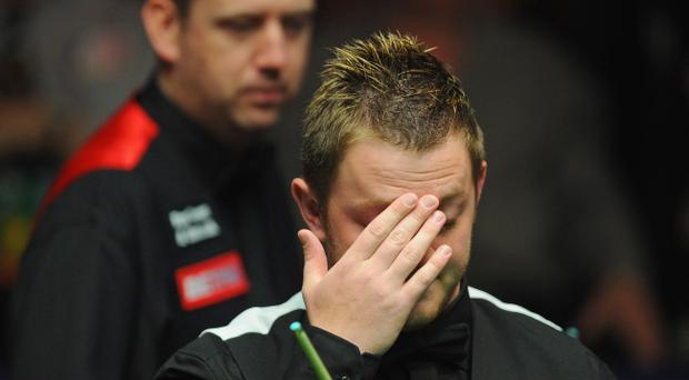 SHEFFIELD, ENGLAND - APRIL 27: Mark Allen of Northern Ireland looks dejected as Mark Williams of Wales looks on during their quarter-final match on day twelve of the Betfred.com World Snooker Championship at the Crucible on April 27, 2011 in Sheffield, England. (Photo by Michael Regan/Getty Images)