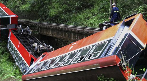 Five Chinese tourists have been killed in a train crash in Taiwan (AP)