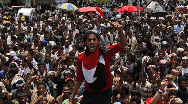 Anti-government protesters take to the streets in Sanaa, Yemen (AP)