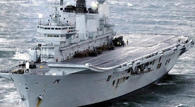 The final costs of two new Royal Navy aircraft carriers will not be known until the end of next year, the Government said