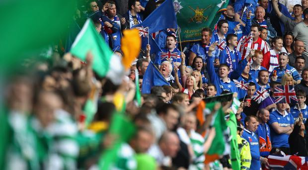Rangers supporters chant before the Clydesdale Bank Premier League match between Rangers and Celtic at Ibrox Stadium on April 24, 2011 in Glasgow, Scotland