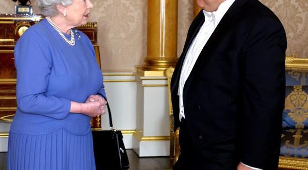 Syrian ambassador Sami Khiyami - pictured meeting the Queen - has had his invitation to the royal wedding withdrawn