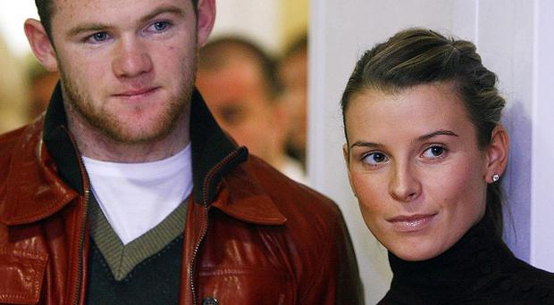 Wayne Rooney and his wife Coleen have both tweeted about the footballer talking to police over alleged newspaper phone hacking
