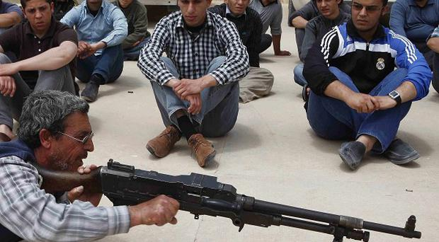 New recruits learn how to use weapons at a training base in Misrata, Libya (AP)