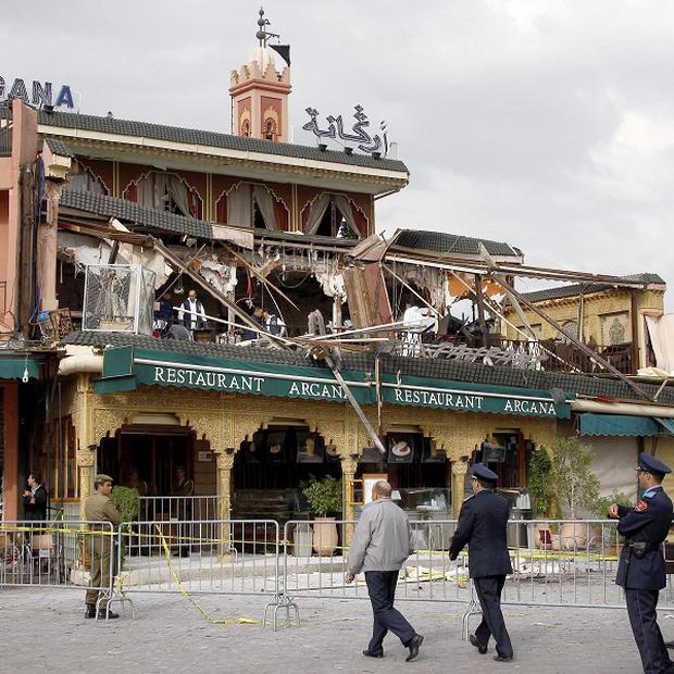 Police officers secure the scene of an explosion at the Argana cafe in Djemma el-Fna square, Marrakech, Morocco (AP)