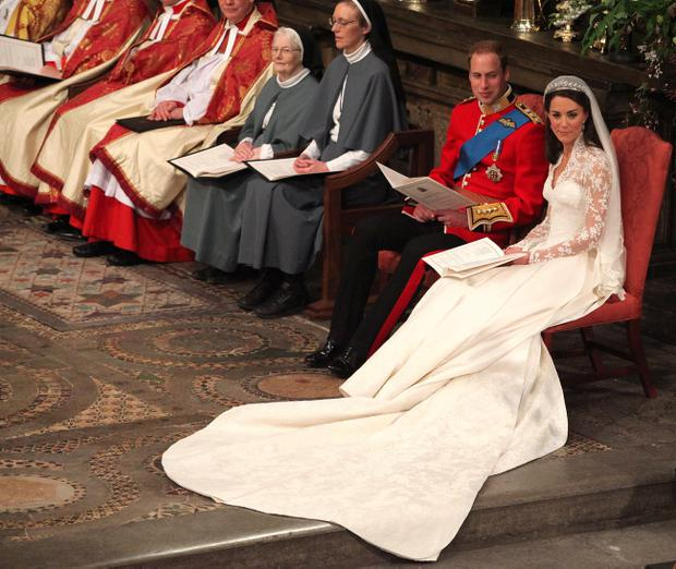 LONDON, ENGLAND - APRIL 29: Prince William and Catherine Middleton during their wedding service in Westminster Abbey on April 29, 2011 in London, England. The marriage of the second in line to the British throne is being led by the Archbishop of Canterbury and will be attended by 1900 guests, including foreign Royal family members and heads of state. Thousands of well-wishers from around the world have also flocked to London to witness the spectacle and pageantry of the Royal Wedding. (Photo by Anthony Devlin - WPA Pool/Getty Images)