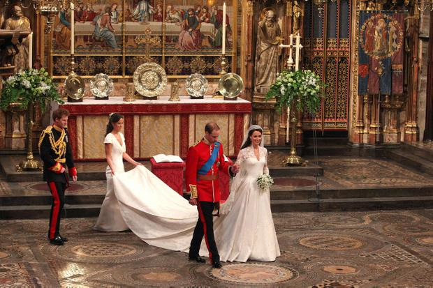 Prince William and his new bride Kate walk leave Westminster Abbey, London, following their marriage, followed by Prince Harry and Pippa Middleton