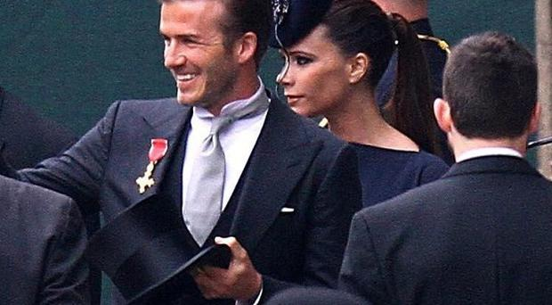 David and Victoria Beckham arrive for the royal wedding