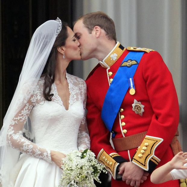 Prince William kisses his new bride Kate on the balcony of Buckingham Palace (AP)
