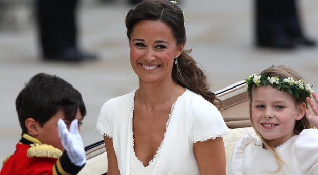 Pippa Middleton joins the procession to Buckingham Palace after the wedding ceremony between Prince William and his new bride Kate