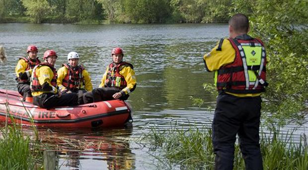 A dive rescue team at the scene on a lake in the village of Langford, Essex, where a a light aircraft crashed (Essex County Fire and Rescue Service)