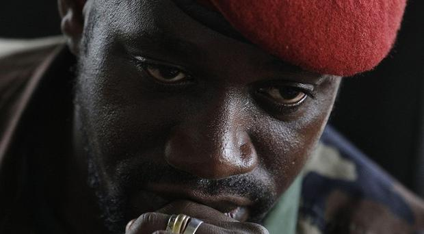 Ivory Coast warlord Ibrahim 'IB' Coulibaly was badly beaten before being shot in the chest