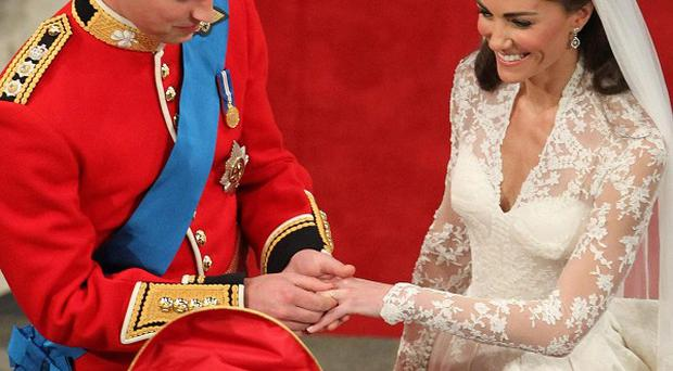 Prince William took a moment to put the wedding ring on Kate's finger