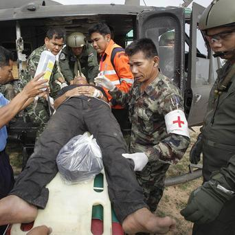 An injured Thai soldier is transferred to hospital following clashes between Thailand and Cambodia in Surin province (AP)