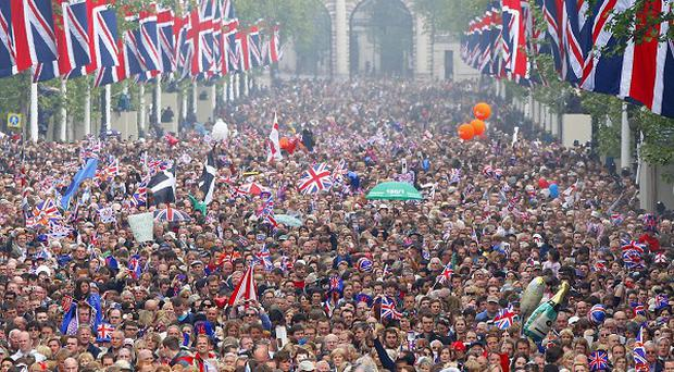 Crowds fill The Mall outside Buckingham Palace after the wedding ceremony