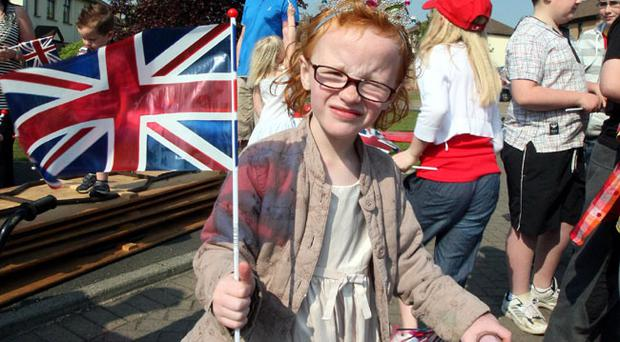 Melissa Whyte, five, from Carrickfergus, County Antrim, celebrates as Prince William is to become Baron Carrickfergus