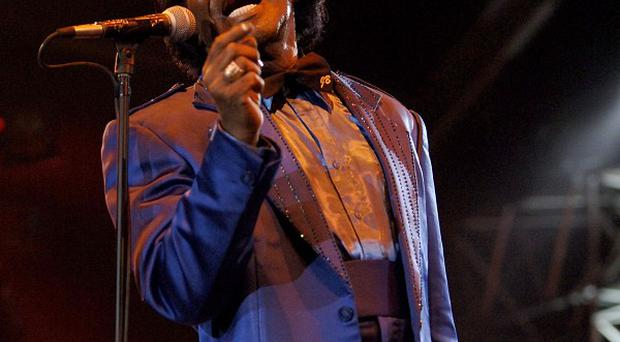 The makers of James Brown's capes are being sued by the late star's daughter