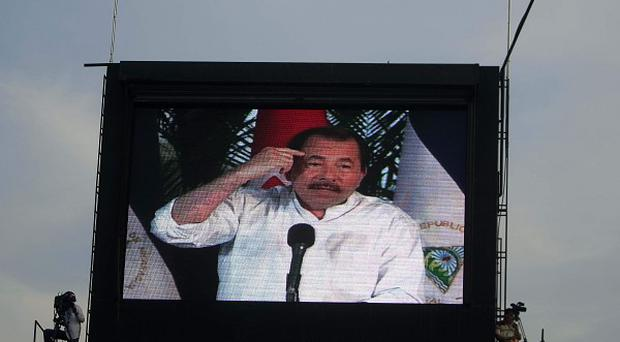 Nicaragua's president Daniel Ortega is seen on a video screen during a Labour Day celebration in Managua (AP)