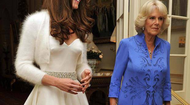 Kate changed into a white satin dress, teamed with a short angora cardigan