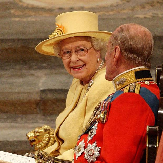 The Queen and Duke of Edinburgh share a smile during the ceremony