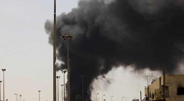 A giant column of smoke rises in the besieged city of Misrata, Libya, as Nato rejects a ceasefire call (AP)