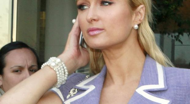 A jury has convicted a man of trying to rob Paris Hilton's Los Angeles home