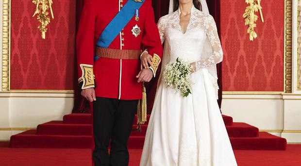 The bride and groom in the throne room at Buckingham Palace
