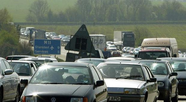 Two people have been killed in a crash between a coach and a lorry on the M11 motorway