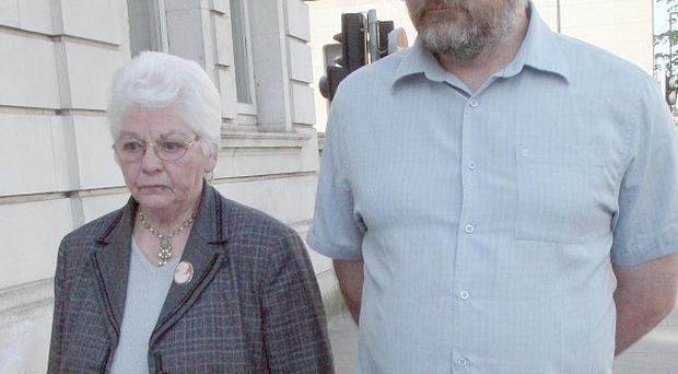 John Beattie's son William and wife Margaret arrive at the inquest at Mays Chambers, Belfast (PA)