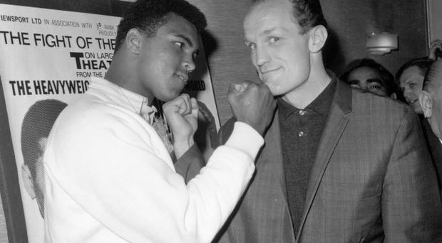 (FILE PHOTO) 10th May 1966: American boxer and world heavyweight champion Muhammad Ali and British champion Henry Cooper before their world heavyweight title fight in London. Ali went on to win the match and retain his title. Sir Henry Cooper OBE has died on May 1, 2011 aged 76. (Photo by Aubrey Hart/Evening Standard/Getty Images)