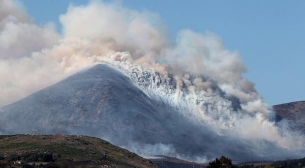 Smoke blankets the slopes of Slievelamagan as fires rage in the Mourne Mountains yesterday
