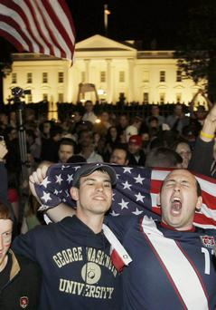 Crowds celebrate on Pennsylvania Avenue in front of the White House in Washington, early Monday, May 2, 2011, after President Barack Obama announced that Osama bin Laden had been killed.