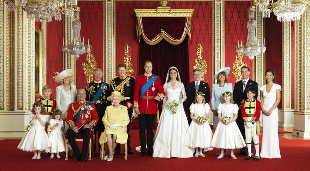 The bride and groom Prince William, Duke of Cambridge and Catherine, Duchess of Cambridge pose for an official photo with left to right): Miss Grace van Cutsem, Miss Eliza Lopes, HRH The Duke of Edinburgh, HM The Queen, The Hon. Margarita Armstrong-Jones, Lady Louise Windsor, Master William Lowther-Pinkerton. Back Row (left to right): Master Tom Pettifer, HRH Camilla, Duchess of Cornwall, Prince Charles, Prince of Wales, HRH Prince Harry of Wales, Mr Michael Middleton, Mrs Michael Middleton, Mr James Middleton, Miss Philippa Middleton, in the throne room at Buckingham Palace on April 29, 2011in London, England.