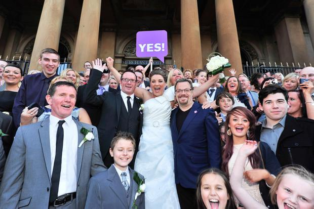 After saying 'I do' Camille Watson and Kieran McNulty said yes to AV champion, stand-up comedian and actor Eddie Izzard, campaigning in the Cathedral Quarter area of Belfast for a 'yes' vote in Thursday's referendum as part of his tour of the UK