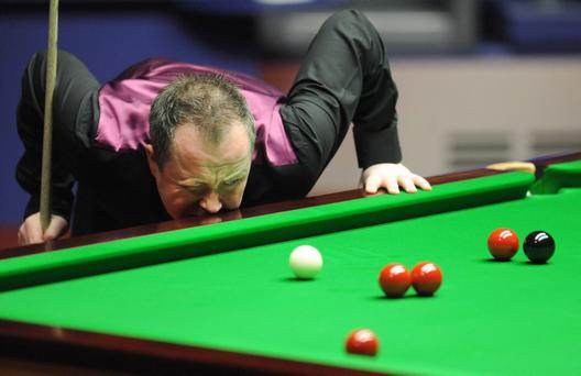 Scotland's John Higgins at the table during the final at the Betfred.com World Snooker Championships at the Crucible, Sheffield