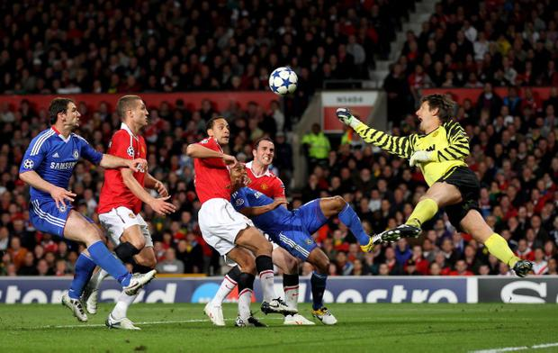 Manchester United goalkeeper Edwin Van der Sar thwarts a Chelsea attack during the last game beween the two teams, in the Champions League quarter-final second leg at Old Trafford in April