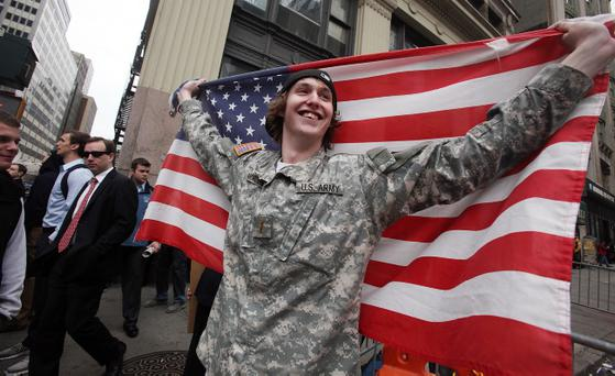 NEW YORK, NY - MAY 02: Kevin Van Orden, whose brother is in the U.S. Army, celebrates outside the World Trade Center site after the death of accused 9/11 mastermind Osama bin Laden was announced May 2, 2011 in New York City. Bin Laden was killed in an operation by U.S. Navy Seals in a compound in Abbottabad, Pakistan. (Photo by Mario Tama/Getty Images)