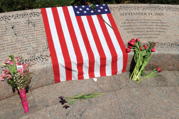 BOSTON, MA - MAY 2: Flowers and an American flag lay on the Garden of Remembrance May 2, 2011 in the Boston Public Garden in Boston, Massachusetts. Families of local victims of the Sept. 11, 2001 terrorist attacks gathered at the 9/11 memorial to reflect upon the death of Osama Bin Laden. Photo by Darren McCollester/Getty Images)
