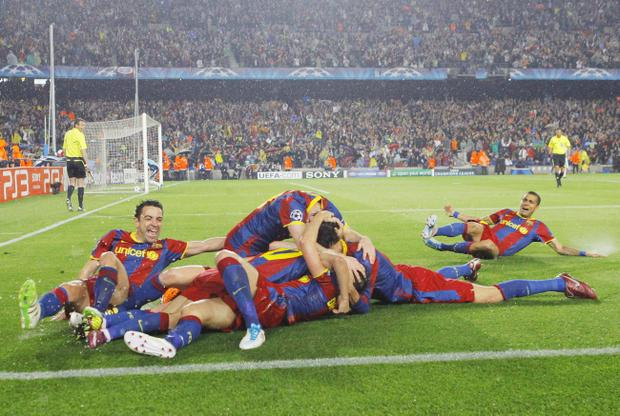 FC Barcelona's Pedro Rodriguez, unseen, celebrates his goal with team mates during a semi final, 2nd leg Champions League soccer match against Real Madrid at the Camp Nou stadium in Barcelona on Tuesday, May 3, 2011. (AP Photo/Andres Kudacki)