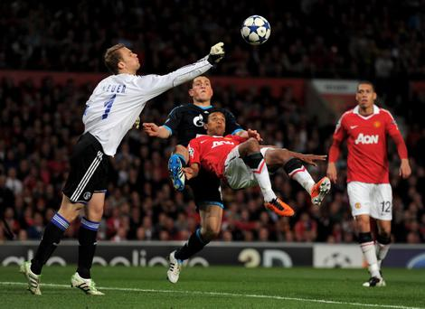 MANCHESTER, ENGLAND - MAY 04: Manuel Neuer of Schalke punches clear under pressure from Nani of Manchester United during the UEFA Champions League Semi Final second leg match between Manchester United and Schalke at Old Trafford on May 4, 2011 in Manchester, England. (Photo by Michael Regan/Getty Images)
